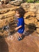 Boy playing in Bucanoo Bay water