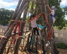 Kids climbing on tipi