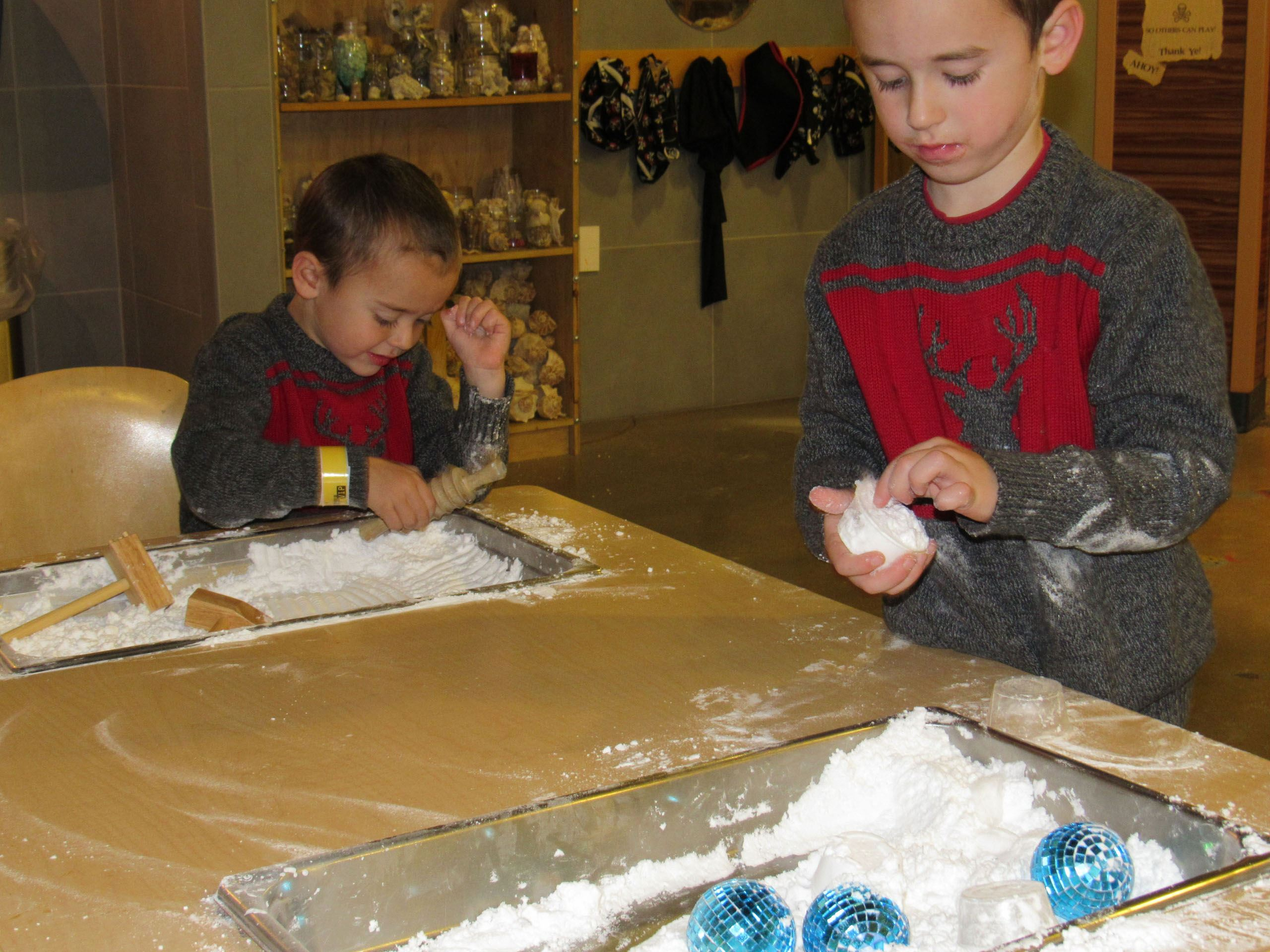 Boys playing with snow activity