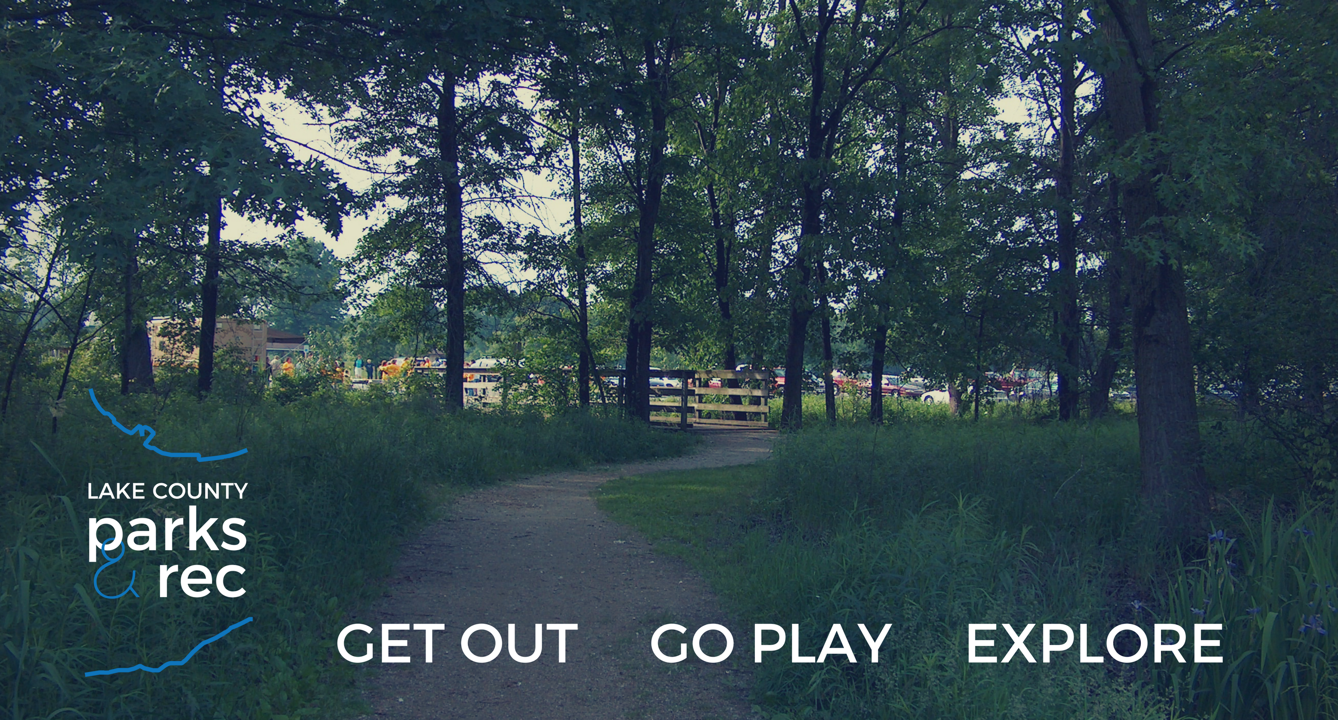 Wooded trail with logo and text reading Get out Go Play Explore