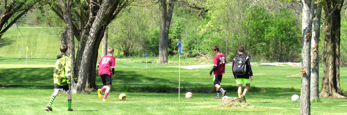 Boys playing Foot Golf