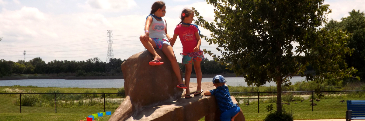 Kids climbing on rock structure